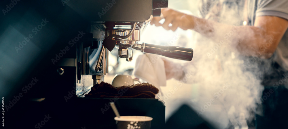 Fototapeta banner size of barista working makeing coffee with coffee machine color tone