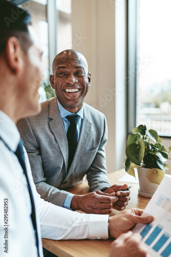 African American businessman laughing with a colleague in an off Canvas Print