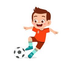 Cute Kid Boy Play Soccer As Striker