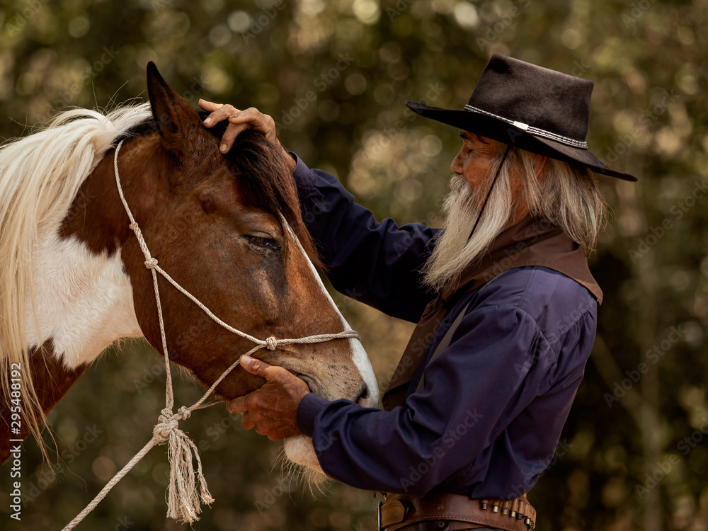 Fototapety, obrazy: Cowboy touches the horse with love