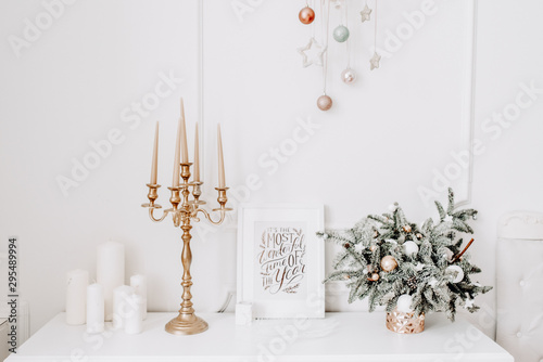 Obraz Merry christmas and new year brick wall background. white decor with fir trees and lamps - fototapety do salonu