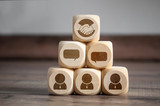Cubes and dice with handshake icon and win-win-situation on wooden background