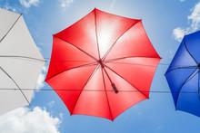 Umbrella On Background Of Blue Sky