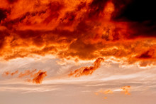 Dramatic Sunset Like Fire In The Sky With Golden And Red Clouds. Beautiful Abstract Colorful Background. Selective Focus
