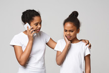 Little Black Girl Suffering From Tooth Pain On Grey Background