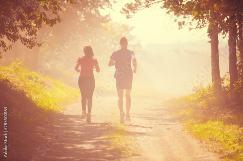 fototapeta na ścianę young couple jogging on sunny day at nature