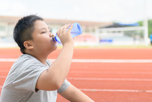 Fat Asian Boy Drink Water From...