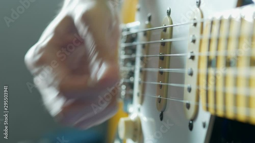 Fototapeta  playing electric guitar with pick