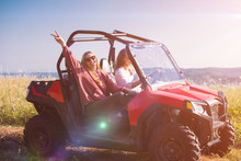 Two Young Women Driving A Off Road Buggy Car