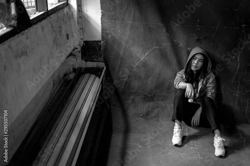 Woman sitting on the floor with substance abuse, substance abuse, addiction, people and drug use concept, copy space background for text Canvas Print