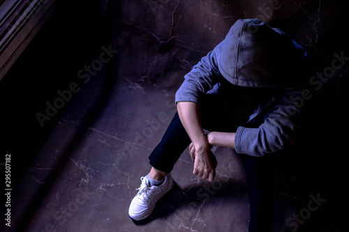 Drugged woman sitting on the floor with substance abuse, substance abuse, addiction, people and drug use concept, copy space background for text Wallpaper Mural