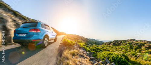 Fototapeta SUV car in spain mountain landscape road at sunset obraz