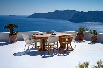 Romantic mediterraen vacation lunch on a rooftop over the sea in Santorini