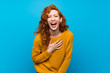 canvas print picture - Redhead woman with yellow sweater smiling a lot