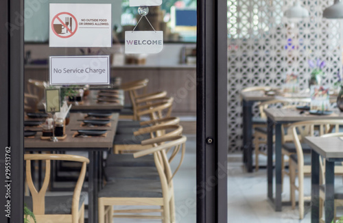 Cuadros en Lienzo Welcome sign outside a restaurant, store, office or other