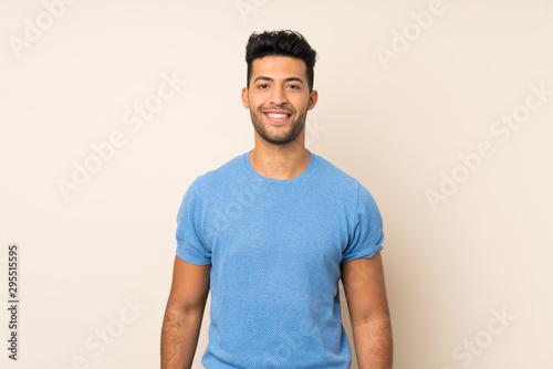 Fototapeta Young handsome man over isolated background keeping the arms crossed in frontal position obraz