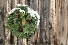 Wreaths Adorn Rustic Wood Fenc...