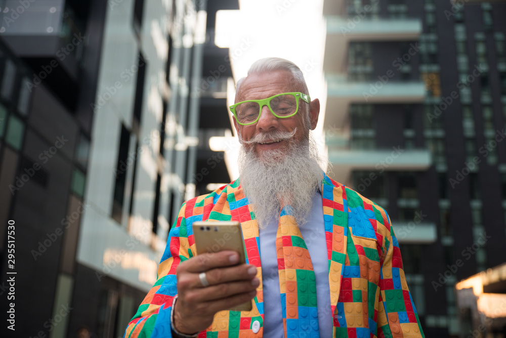 Fototapeta Youthful stylish senior man with hipster outfit