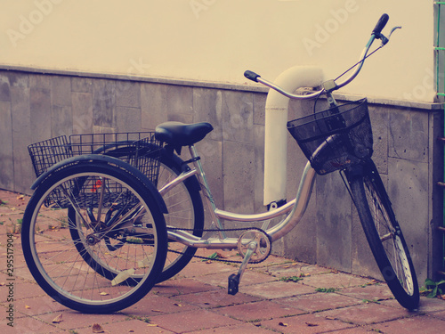 Tuinposter Fiets Tricycle for adults in the city, vintage toned