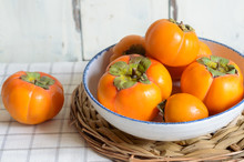Ripe Persimmon Fruit, Isolated On White Wooden Background