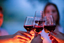 Friends Toasting Red Wine Glas...