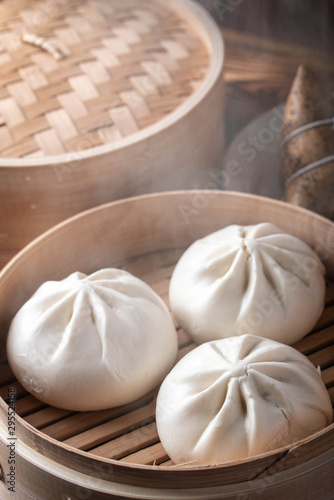 chinese steamed bun in traditional bamboo steamer Canvas Print