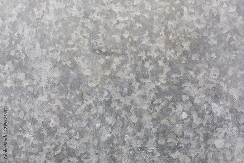 Cuadros en Lienzo spotted a grey galvanized surface background