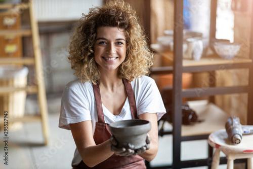 Obraz Portrait of woman pottery artist in art studio - fototapety do salonu