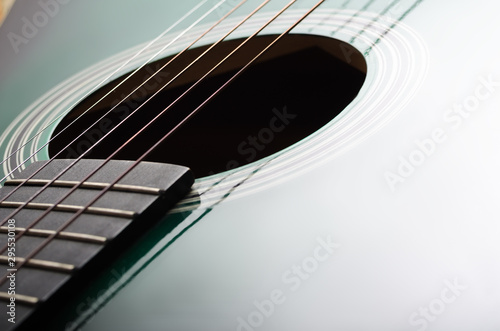 Valokuva  Acoustic guitar fretboard. Close up.