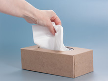 Paper Tissue Box On Blue Background