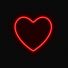 Neon Heart. Brightly Red Neon Sign With Night Illumination On A Black Brick Wall.