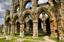Eroded Stone Arches And Pillars Of The Gothic Ruins Of Whitby Abbey Church Chancel North York Moors National Park England