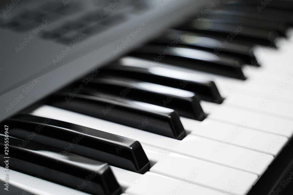 Fototapety, obrazy: Professional midi keyboard synthesizer with knobs and controllers.