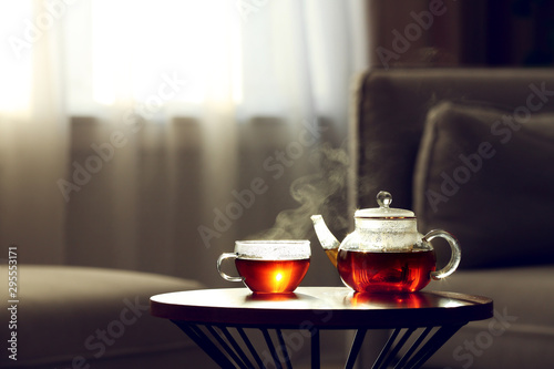 Papiers peints The Teapot and cup of fresh hot tea on table against blurred background. Space for text