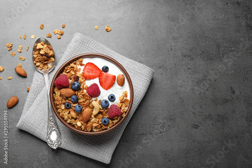 Photo sur Toile Pays d Europe Tasty homemade granola served on grey table, flat lay with space for text. Healthy breakfast
