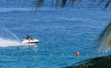 A Man Riding Jet Ski In The Sea, White Beach