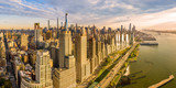 Fototapeta Nowy Jork - Aerial panorama of New York City waterfront skyline at sunset viewed from above River Side Park, along Joe DiMaggio highway and Riverside Blvd, next to Hudson River.