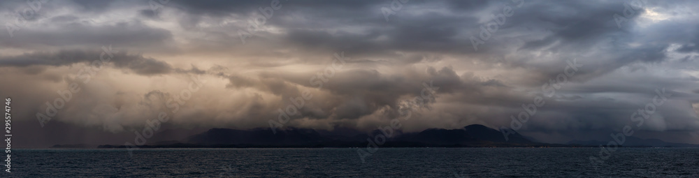 Fototapety, obrazy: Dramatic Panoramic View of a cloudscape during a dark, rainy and colorful sunset. Taken on the Ocean Coast of Alaska, USA.