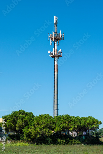 Fotografia, Obraz 5G antenna outside the city. GSM Antenna in the nature.