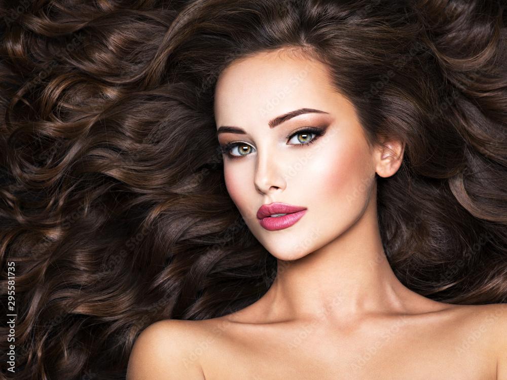 Fototapeta Beautiful woman with long bown hair