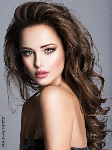 Obraz na plátně  Beautiful woman with long bown hair