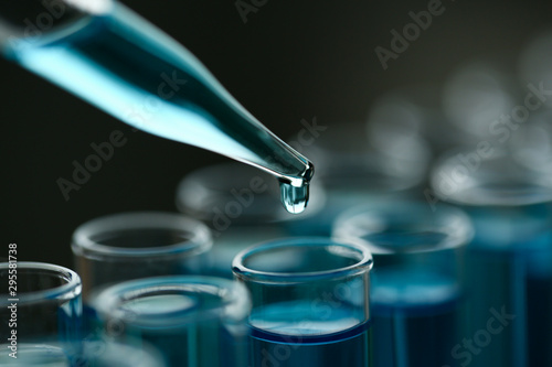 Fotomural Test tube of glass overflows new liquid solution potassium blue conducts an analysis reaction takes various versions reagents using chemical pharmaceutics cancer manufacturing