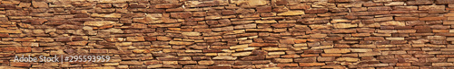 Photo Stacked stone wall texture backround
