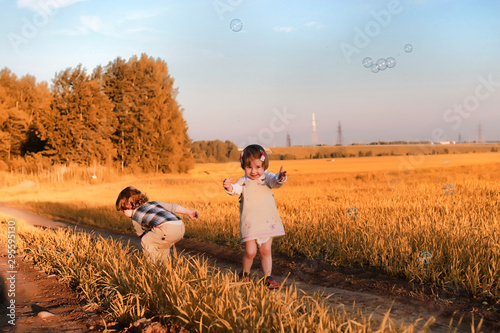 Children outdoors in a field