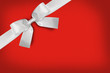 canvas print picture White gift bow on red