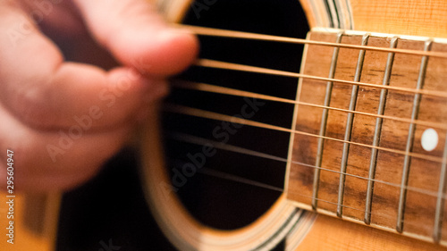 Fototapeta Detail of man playing an acoustic guitar. 16:9 image