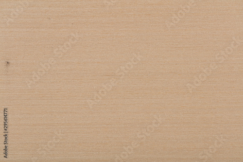 Light beige maple veneer background as part of your design. High quality texture.