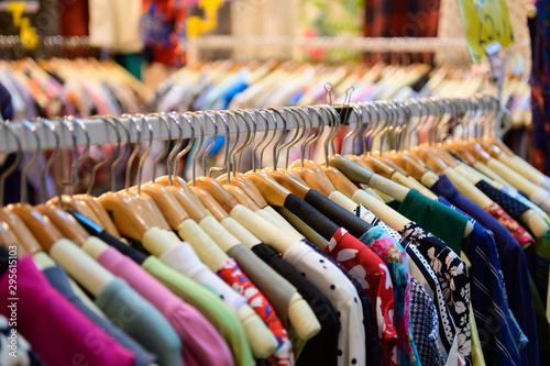 Fotografie, Obraz  Colorful women's dresses on hangers in a retail shop