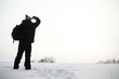 Leinwandbild Motiv A man on a walk. Winter landscape. Tourist in winter journey.