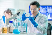 Asian Scientist Take Petri Dish